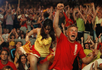 Spanish fans react during their Euro 2012 soccer match against Croatia at a fan zone in Gdansk