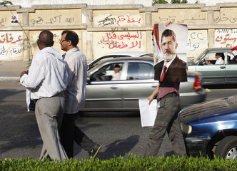 A members of the Muslim Brotherhood and supporter of deposed Egyptian President Mursi leaves the sit-in area of Rab'a al- Adawiya Square