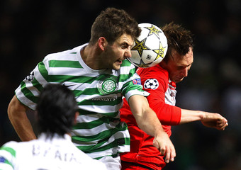 Celtic's Mulgrew and Spartak Moscow's Kallstrom clash for the ball during their Champions League soccer match in Glasgow