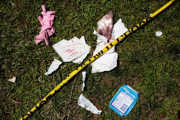Bloody bandages and police tape lay on the lawn of the California State Capitol after multiple people were stabbed during a clash between neo-Nazis holding a permitted rally and counter-protestors on Sunday in Sacramento.