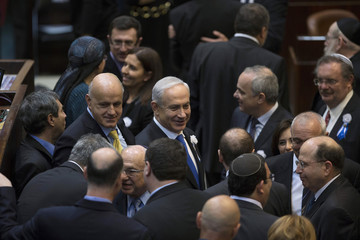 Israel's Prime Minister Benjamin Netanyahu greets members of the 19th Knesset after their swearing-in ceremony in Jerusalem