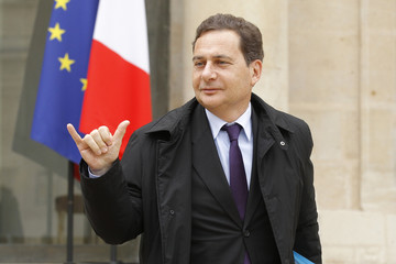 Eric Besson, France's Industry and Energy Ministrer, leaves the Elysee Palace in Paris at the end of the weekly cabinet meeting