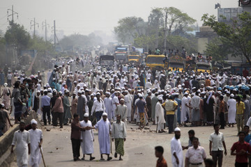 Members of the Islami Oikyo Jote barricade a highway during a daylong strike in Dhaka