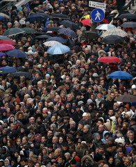 Faithful stands in queue at the entrance of St.Peter's Square before Pope Francis opens a Catholic Holy Year, or Jubilee