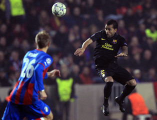 Barcelona's Alves is challenged by Kolar of Viktoria Plzen during their Champions League Group H soccer match in Prague