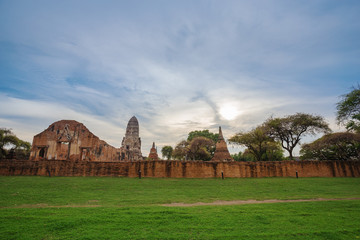 Ruins of buddha statues and pagoda of Wat Ratcha Burana in Ayutthaya historical park, Thailand