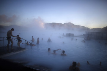 People relax in one of the Blue Lagoon hot springs near the town of Grindavik
