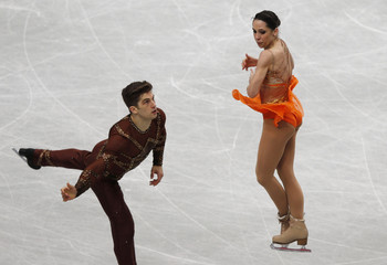 Italy's Nicole Della Monica and Matteo Guarise compete during the pairs short program at the ISU World Figure Skating Championships in Saitama, Japan