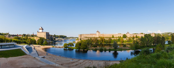 Narva and Ivangorod Fortress on the border of Estonia and Russia. Summer day panoramic view.