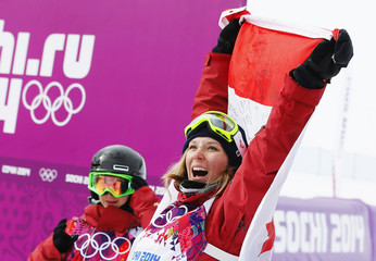 Winner Canada's Dara Howell celebrates with the Canadian flag as compatriot and third-placed Kim Lamarre looks on after the women's freestyle skiing slopestyle finals at the 2014 Sochi Winter Olympic Games in Rosa Khutor