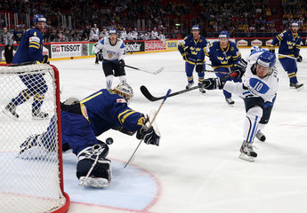 Sweden's Enroth makes a save against a shot by Finland's Hagman during their 2013 IIHF Ice Hockey World Championship semi-final match at the Globe Arena in Stockholm