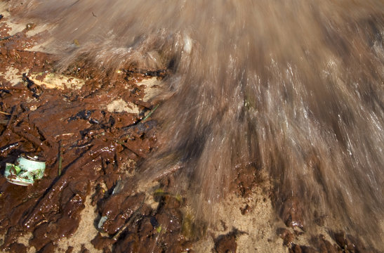 Oil and debris are seen on a beach in Singapore