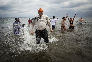 Participants take part in Courage Polar Bear Dip at Coronation Park in Oakville