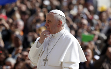Pope Francis looks on as he arrives at the weekly audience in Saint Peter's Square at the Vatican