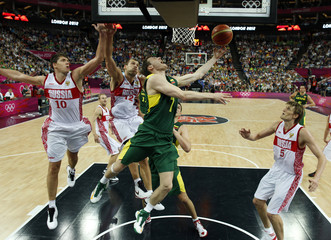 Lithuania's Pocius goes in for a lay-up as Russia's Khryapa, Monya and Kirilenko guard during their men's quarterfinal basketball match at the North Greenwich Arena in London during the London 2012 Olympic Games