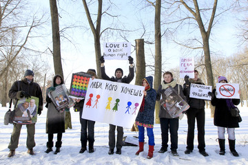 Gay rights activists shout slogans and hold placards during the first-ever sanctioned Gay, Lesbian and Bisexual Pride picket near the Department of Justice in Minsk