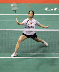 China's Wang returns a shot to Denmark's  Baun during their match at the Singapore Badminton Open