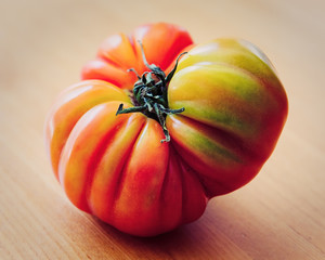 Heirloom Tomato on a Wooden Table