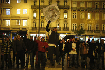 Demonstrators protest in front of the palace where a conference about the Portuguese economy is ongoing, in Lisbon