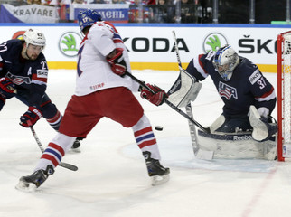 Sobotka of the Czech Republic tries to score past goaltender Hellebuyck of the U.S. during their Ice Hockey World Championship third-place game at the O2 arena in Prague