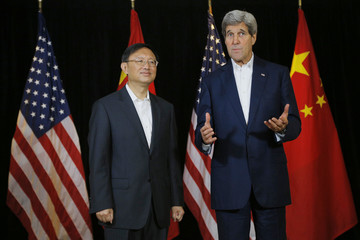 China's State Councillor Yang listens as United States Secretary of State Kerry makes a few remarks to reporters in Boston