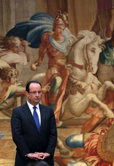 French President Hollande listens during his New Year wishes to civil servants and constitutional bodies at the Elysee Palace in Paris