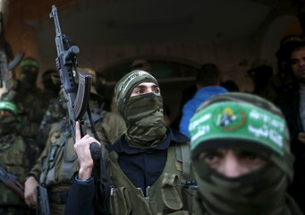 Palestinian Hamas militants take part in the funeral of their two comrades, who were killed when a tunnel collapse on Tuesday, in the village of Al-Moghraga near central Gaza Strip