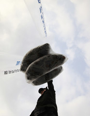 A North Korean defector who lives in South Korea hold balloons carrying anti-North Korea leaflets before releasing them at the Imjinkak pavilion, near the demilitarized zone (DMZ) which separates the two Koreas in Paju