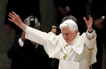 Pope Benedict XVI waves as he leads an audience to commemorate the 400th anniversary of Father Matteo Ricci's death at the Vatican