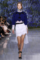 A model presents a creation by Belgian designer Raf Simons as part of his Spring/Summer 2016 women's ready-to-wear fashion show for Christian Dior fashion house in Paris