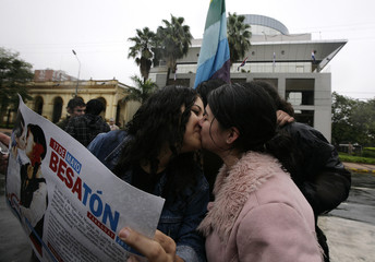 A Paraguayan lesbian couple kiss in front of Congress during the national kissathon to defend gay and lesbian rights, in Asuncion