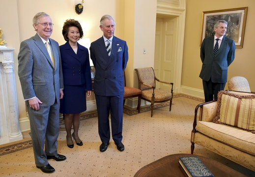 Britain's Prince Charles poses with U.S. Senate Majority Leader McConnell and his wife Chao at the U.S. Capitol in Washington