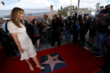 Actor Janney poses on her star after it was unveiled on the Hollywood Walk of Fame in Los Angeles