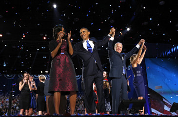U.S. President Obama and first lady Michelle Obama celebrate with Vice President Biden and his wife Jill after his victory speech election night in Chicago
