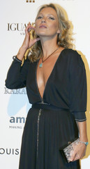 British model Kate Moss arrives for the amfAR Gala in Sao Paulo