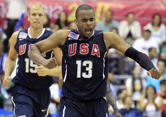 Marcus Lewis of the U.S. celebrates the team's victory over the Dominican Republic in their men's preliminary round basketball game at the Pan American Games in Guadalajara