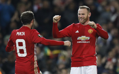 Manchester United's Juan Mata celebrates scoring their second goal  with Wayne Rooney