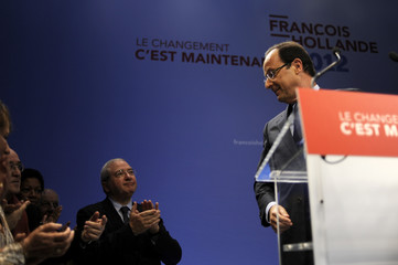 Francois Hollande, France's Socialist Party candidate for the 2012 French presidential election, attends the inauguration of his campaign's headquarters in Paris
