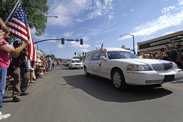 Hearses carrying the remains of the 19 members of the Granite Mountain Hotshots firefighting team move in a motorcade from the Maricopa County Medical Examiner's office in Prescott, Arizona