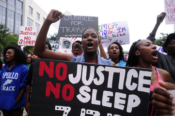 A participant yells during a rally in support of slain teenager Trayvon Martin in Orlando