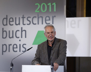 Eugen Ruge speaks after winning the German Book Prize 2011 for his novel In Zeiten des abnehmenden Lichts during a ceremony in Frankfurt