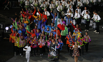 Mexico's flag bearer Maria del Rosario Espinoza holds the national flag as she leads the contingent in the athletes parade during the opening ceremony of the London 2012 Olympic Games at the Olympic Stadium