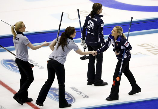 Russia players Saitova and Galkina shake hands with Scotland's Sloan as Scotland skip Muirhead leaves ice after their bronze medal curling match at World Women's Curling Championships in Sapporo