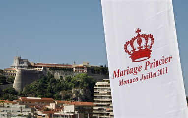 A flag announcing the wedding of Prince Albert II of Monaco and his fiancee Charlene Wittstock flies with Palace in background
