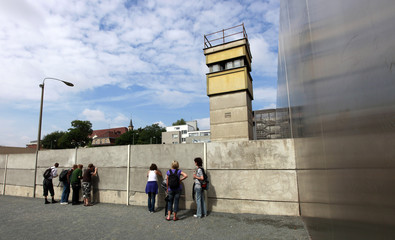 People visit a Berlin Wall memorial at the Bernauer Strasse in Berlin