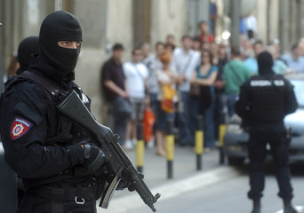 A Serbian Gendarmerie soldier stands guard at the entrance of the Special Court in Belgrade