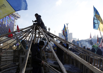 Pro-European integration protesters construct a temporary building on Independence Square in Kiev