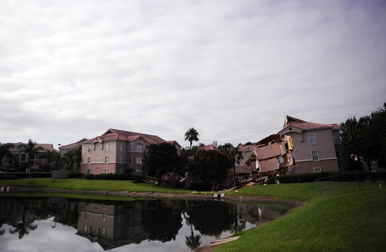 Section of the Summer Bay Resort lies collapsed after a large sinkhole opened on the property's grounds, in Clermont, Florida