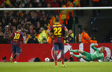 Barcelona's Lionel Messi scores a penalty agaisnt Manchester City during their Champions League round of 16 first leg soccer match at the Etihad Stadium in Manchester