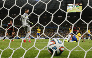 Germany's Sami Khedira scores their fifth goal during their 2014 World Cup semi-finals against Brazil at the Mineirao stadium in Belo Horizonte